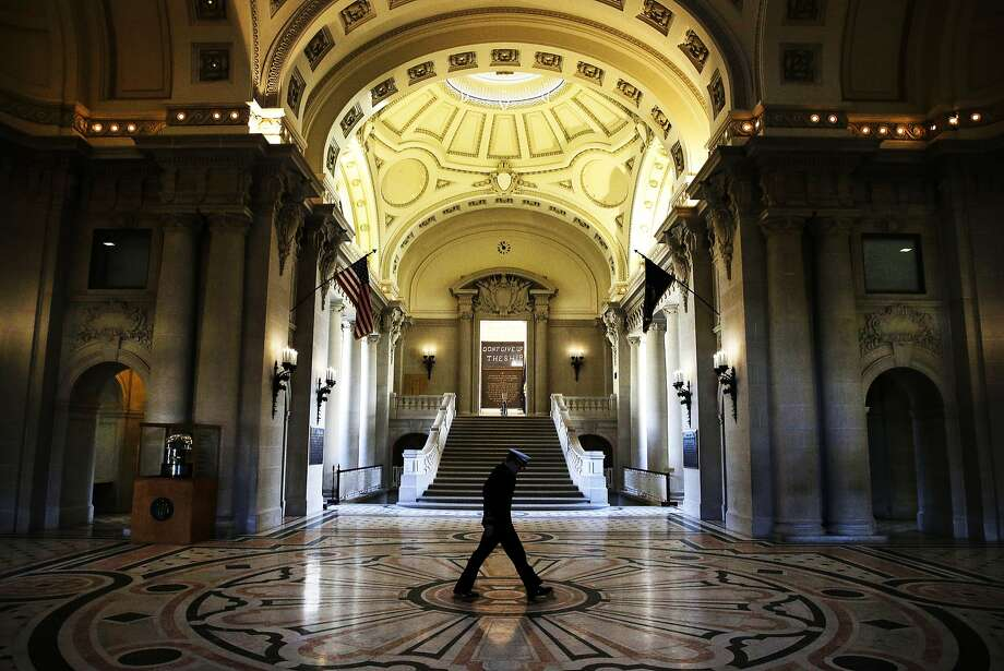 A Midshipman walks inside Bancroft Hall, the main dormitory on the U.S. Naval Academy campus in Annapolis, Md., Thursday, Jan. 9, 2014.  (AP Photo/Patrick Semansky) Photo: Patrick Semansky, Associated Press