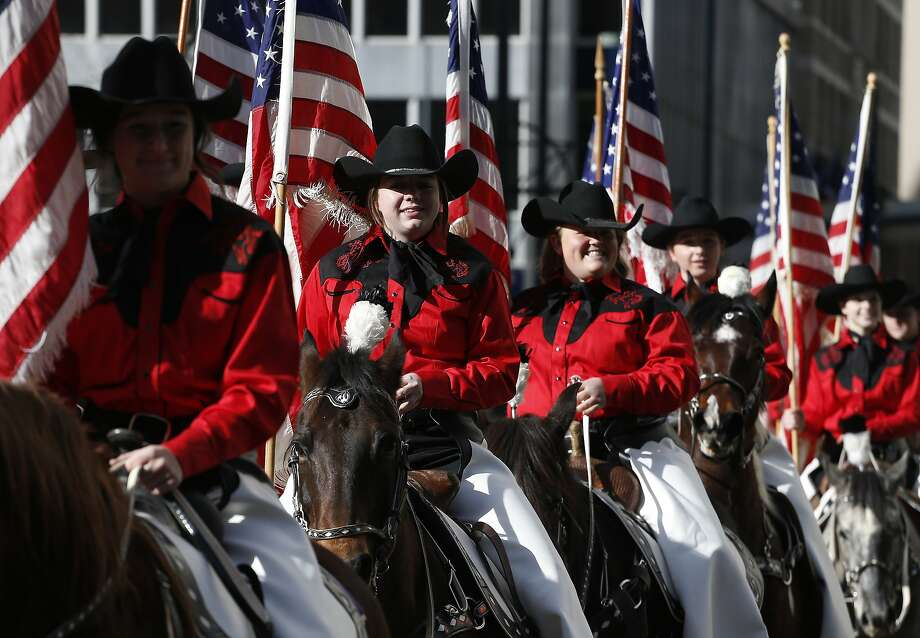 Riders wave from horseback during the National Western Stock Show Parade, in Denver, Thursday Jan. 9, 2014. (AP Photo/Brennan Linsley) Photo: Brennan Linsley, Associated Press