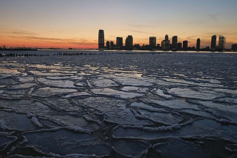 NEW YORK, NY - JANUARY 09:  Ice floes fill the Hudson River as the New Jersey waterfront is seen during sunset on January 9, 2014 in New York City. A recent cold spell, caused by a polar vortex descending from the Arctic, caused the floes to form in the Hudson.  (Photo by Afton Almaraz/Getty Images) ***BESTPIX*** Photo: Afton Almaraz, Getty Images