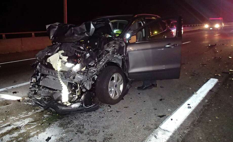 The driver of this Ford Escape SUV was hospitalized for treatment of injuries suffered in a three-vehicle crash early Friday on Interstate 95 in Westport. Photo: Westport Fire Department / Westport News contributed