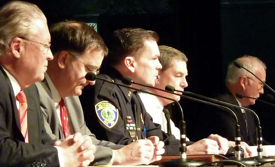 Answering questions at a forum on school safety Thursday are, from left, First Selectman Michael Tetreau, Superintendent of Schools David Title, Police Chief Gary MacNamara, Fire Marshal Bill Kessler and Board of Education Chairman Philip Dwyer. Photo: Genevieve Reilly / Fairfield Citizen