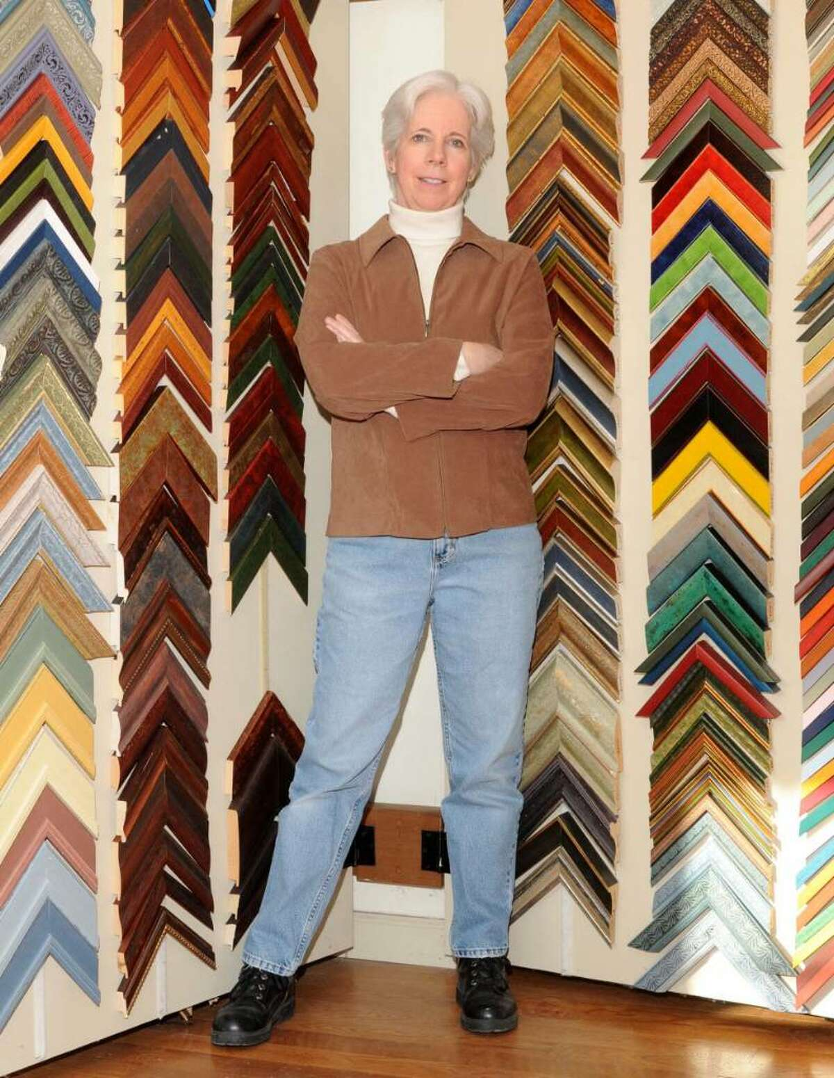 Sue Newton, owner of The Barn Gallery & Framing, in New Fairfield, CT, with some of the sample frame corners in her shop, on Friday, Jan. 29, 2010.