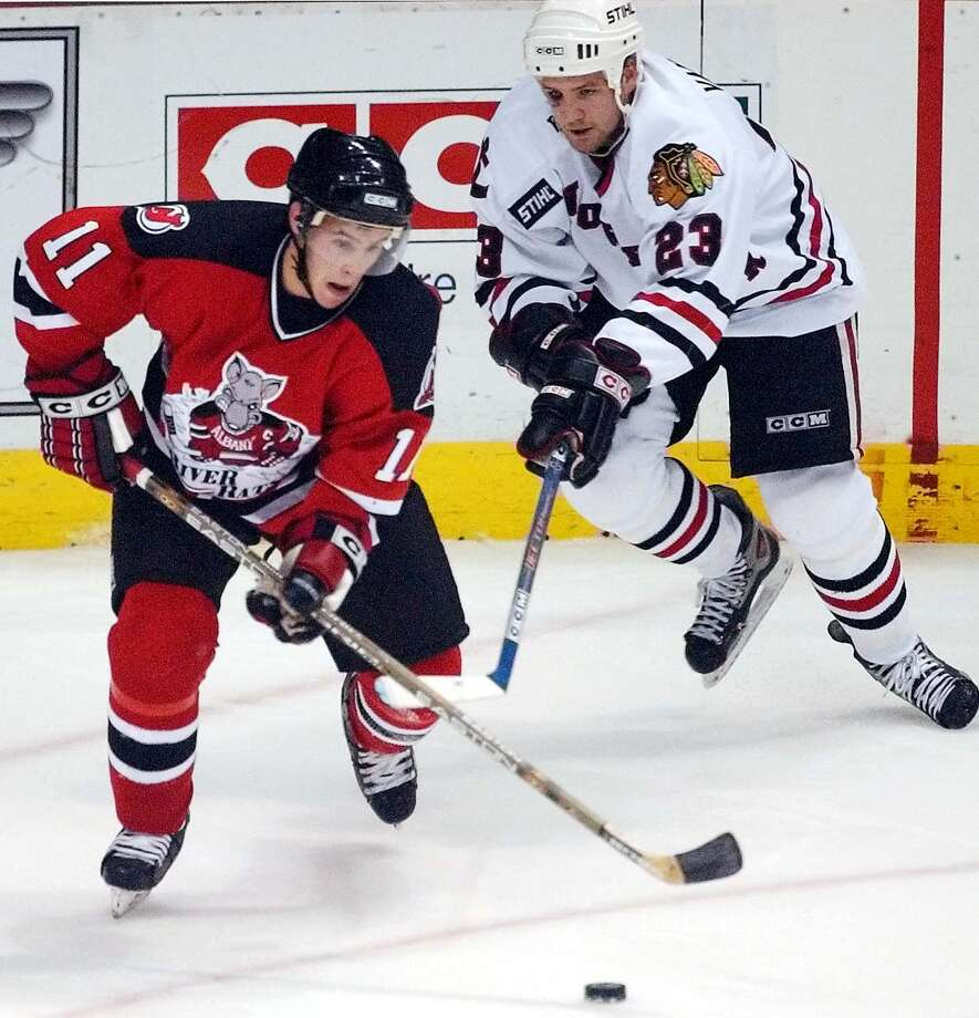 (L. to R.)-Albany River Rats #11-Zach Parise battles Norfolk Admirals #23-Jim Vandermeer for control of the puck in the first period of game at the Pepsi Arena in October 2004. Photo: JAMES GOOLSBY, DG / ALBANY TIMES UNION