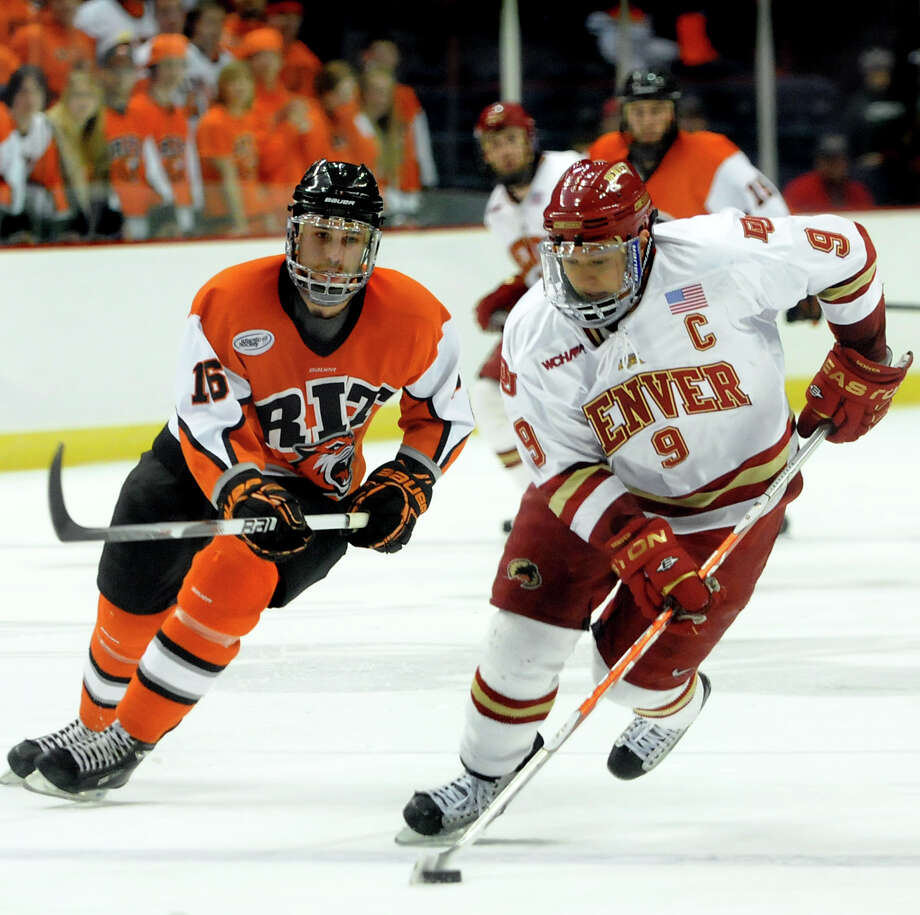 Besides AHL hockey, there have also been some exciting moments in College hockey at the Times Union Center.  After winning in this tournament in 2010, RIT went on to the Frozen Four.Denver's Rhett Rakhshani (9), right, controls the puck as RIT's Tyler Brenner (16), left, defends during their NCAA East Regional hockey game on Friday, March 26, 2010, at Times Union Center in Albany, N.Y.  Photo: CINDY SCHULTZ, ALBANY TIMES UNION / 00008045A