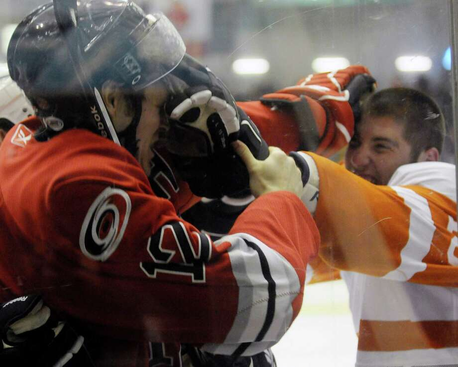 The rivalry continues. Steven Goertzen of the Albany River Rats ,left, and Patrick Maroon of the Adirondack Phantoms fight during the third period of their Hockey game at the Glens Falls Civic Center in Glens Falls, N.Y., Saturday, April 10, 2010. Photo: Hans Pennink, Times Union / 00007698H