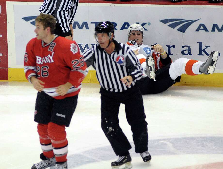 Nicholas Blanchard of the Albany River Rats, left, is taken to the penalty box after fighting with Matt Clackson of the Adirondack Phantoms during the first period of their Ice Hockey game at the Times Union Center in Albany, N.Y., October 24, 2009. Photo: Hans Pennink, Times Union / 00005846F