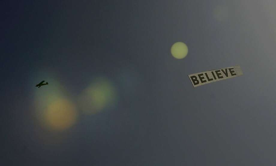 "They might be giant killers: A banner towed by a plane over New Orleans exhorts Saints fans to ""believe"" that their team 