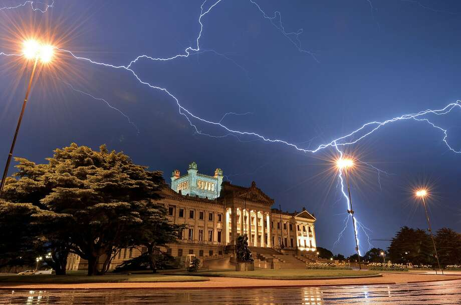 Lightning streaks across the sky above the Legislative Palace seat in Montevideo, the seat of the Uruguayan 