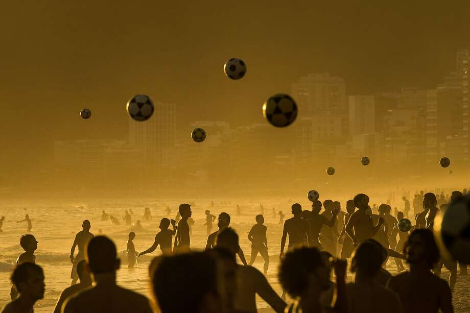 Using heads and feet,soccer enthusiasts keep their balls in the air on Ipanema Beach in Rio de Janeiro. Photo: Yasuyoshi Chiba, AFP/Getty Images