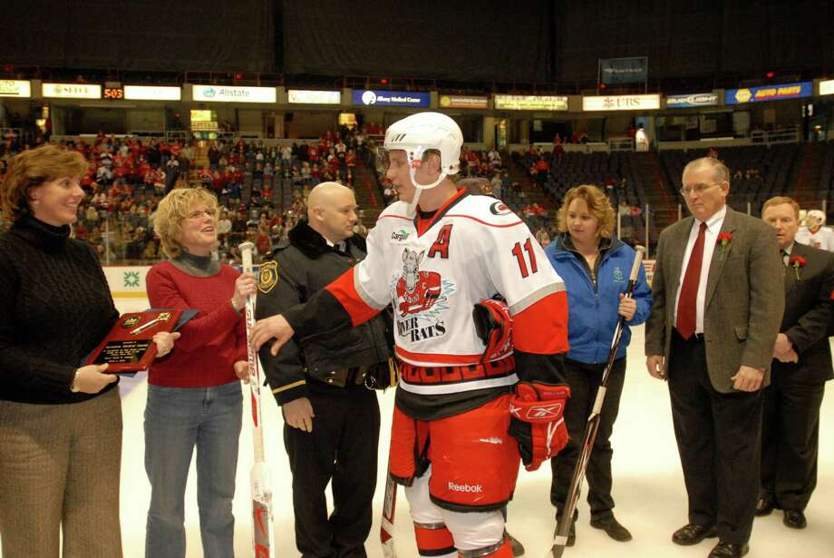 No. 11,  Albany River Rat Assistant Captain, Dwight Helminen thanking EMS, law enforcement, & officials from Berkshire Medical Center, who came to the rescue of the Albany River Rat Hockey Team when they were involved in a bus crash on the Mass Pike, as the Rats took the ice at home at the Times Union Center for the first time since the accident on Sunday, Mar. 1, 2009, Albany, NY.  The emergancy workers were honored in a pregame ceremony on the ice by Albany Mayor Jerry Jennings and Albany Co. Ex. Mike Breslin. Photo: LMF, ALBANY TIMES UNION / 0000515EA