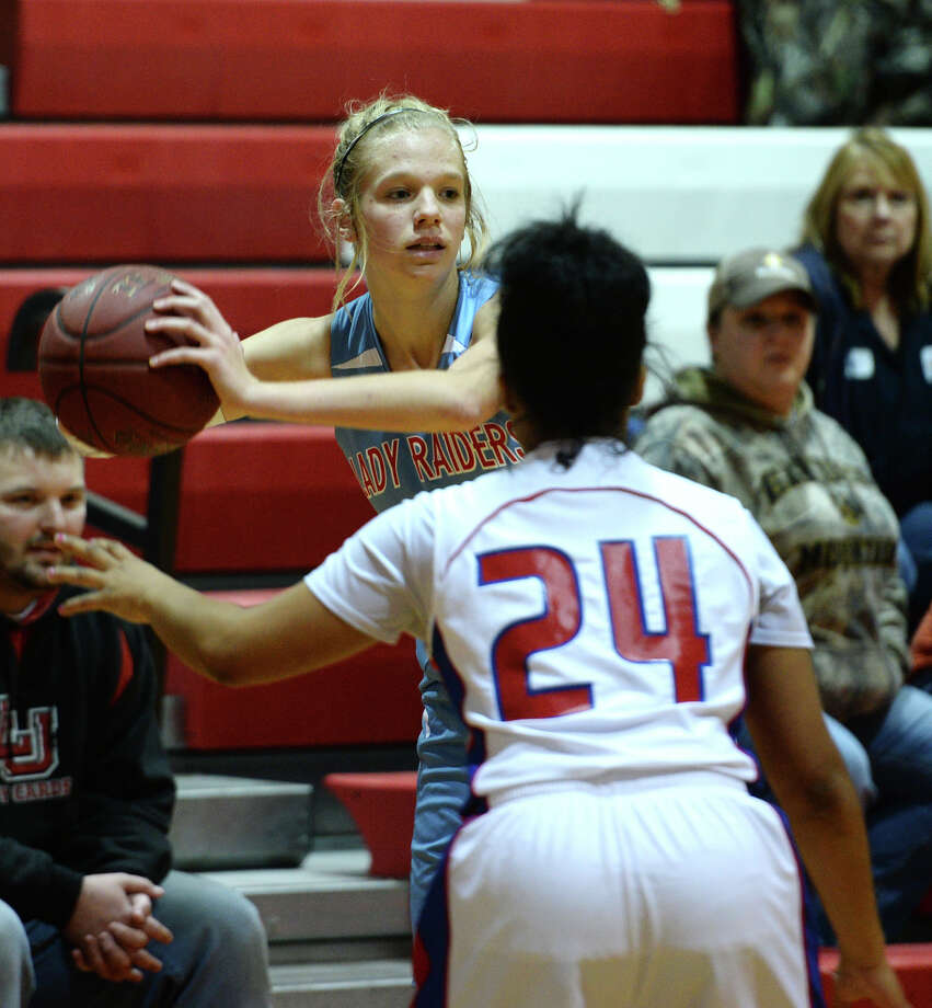 Lumberton's Megan Worry, No. 23, looks for an open teammate while being blocked off by West Brook's Michelle Nolan, No. 24, during Tuesday's game. The Lumberton High School girls varsity basketball team played against West Brook at West Brook High School on Tuesday afternoon. Lumberton beat West Brook with a final score of 30-24. Photo taken Jake Daniels/@JakeD_in_SETX Photo: Jake Daniels / ©2013 The Beaumont Enterprise/Jake Daniels