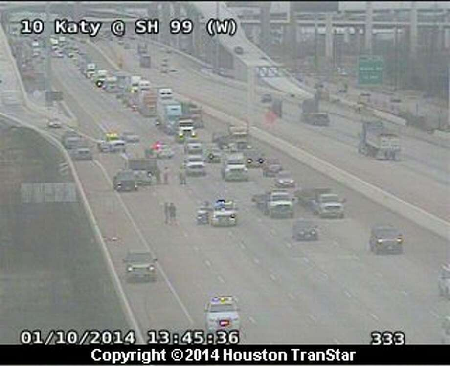 A wreck on the Katy Freeway at the Grand Parkway shutdown four lanes of traffic.
