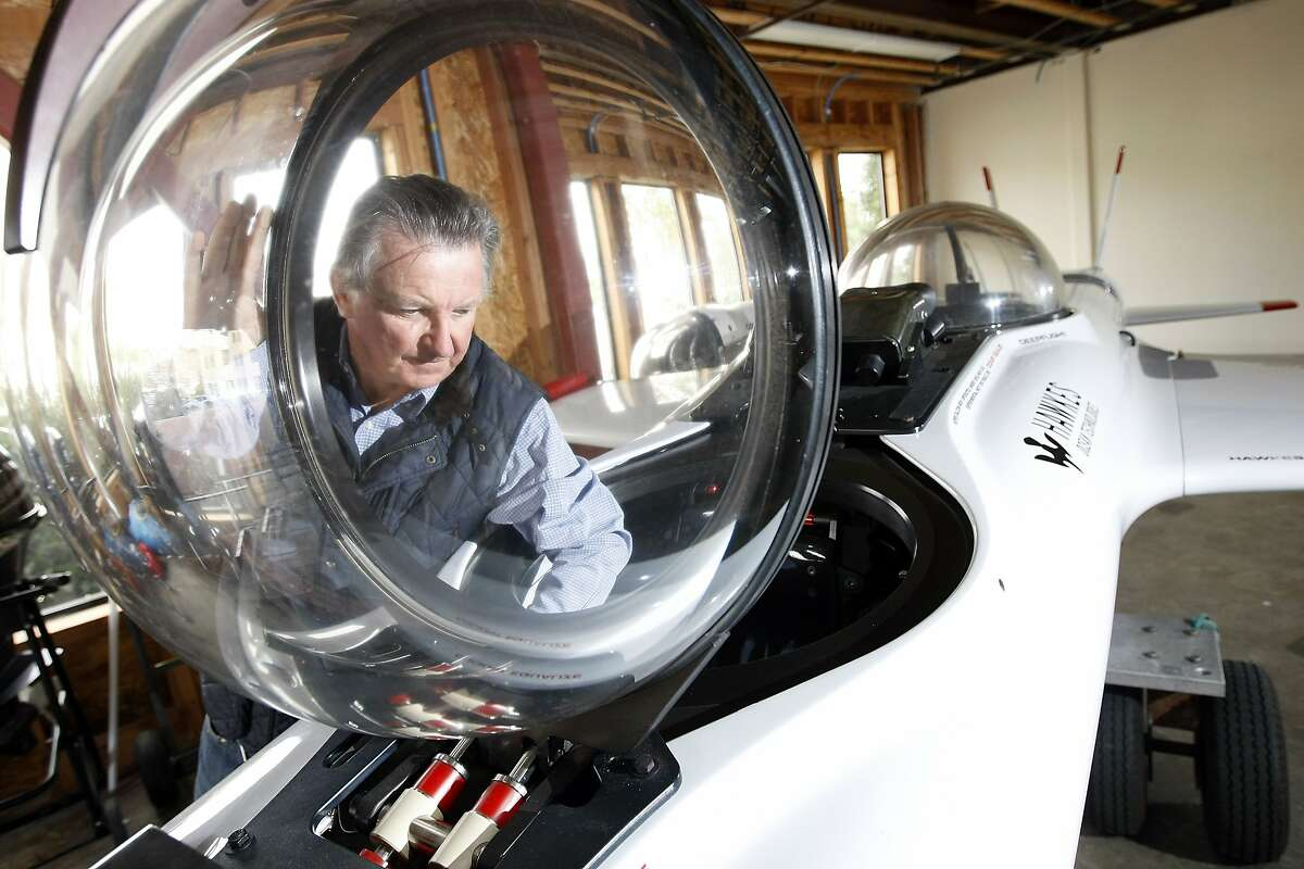 Graham Hawkes, founder of Hawkes Technologies, stands next to the Deep Flight Super Falcon, a 2 man flying submersible vehicle that he and his company designed and sells, in Richmond, CA, Wednesday, January 8, 2014.