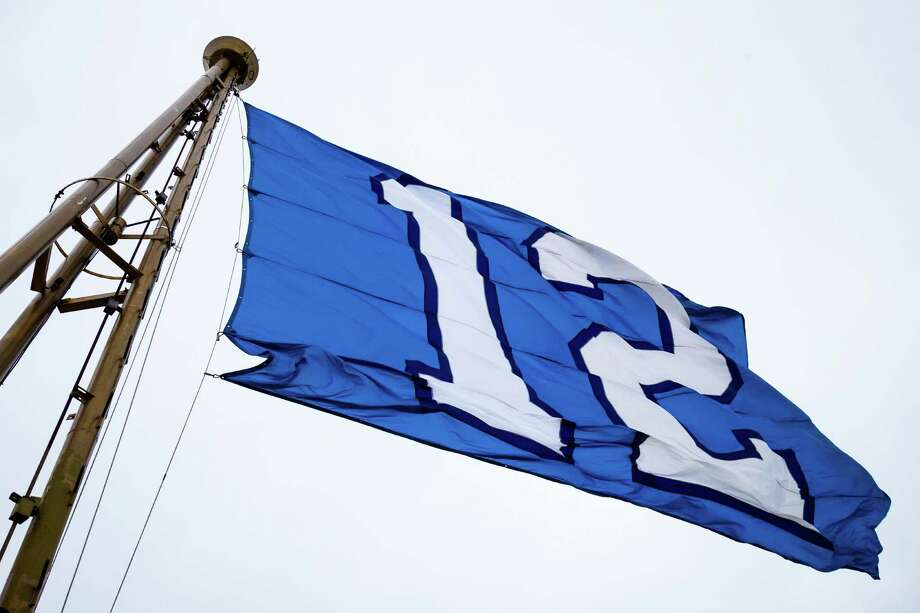 "In celebration of the Seahawks upcoming playoff game, the ""12th Man"" flag is flown at the height of the Space Needle Friday. Photo: JORDAN STEAD, SEATTLEPI.COM / SEATTLEPI.COM"