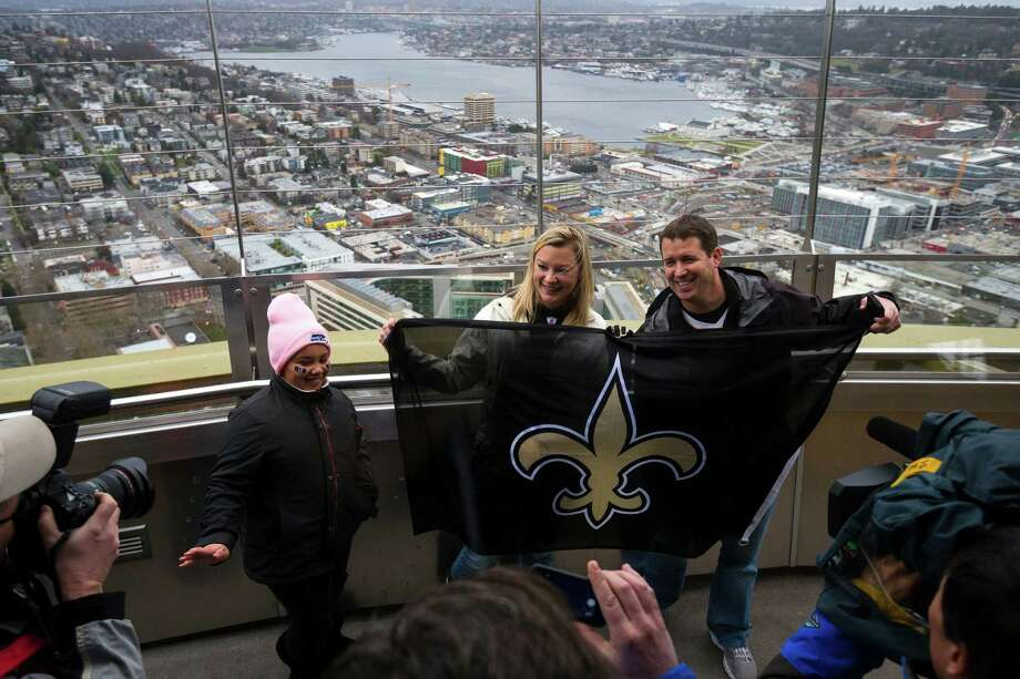 New Orleans Saints fans fly their own flag from the height of the Space Needle Friday. Photo: JORDAN STEAD, SEATTLEPI.COM / SEATTLEPI.COM