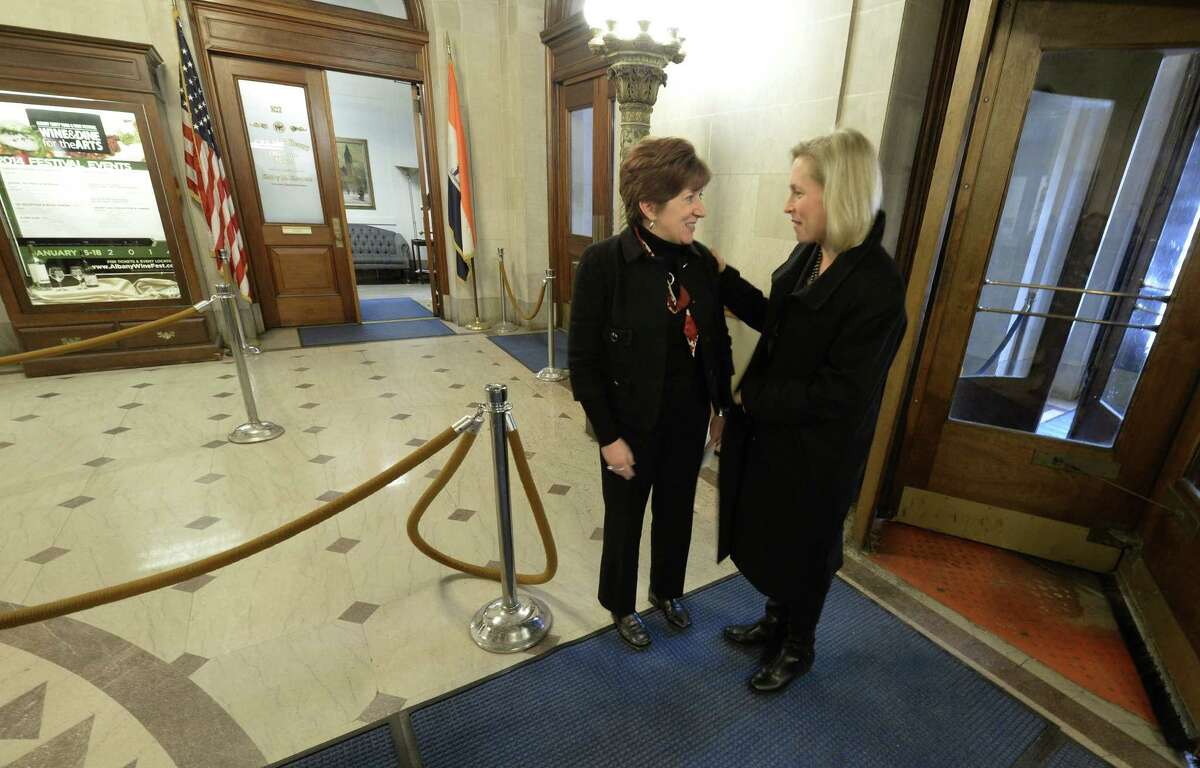 U.S. Senator Kirsten Gillibrand, left, is greeted at the door by Albany Mayor Kathy Sheehan morning, Jan. 10. 2014, at City Hall in Albany, N.Y. Sen. Gillibrand announced new federal legislation that would create paid family and medical leave during a press conference at City Hall. The Family and Medical Insurance Leave (FAMILY) Act would establish a national paid family and medical leave insurance program. (Skip Dickstein / Times Union)