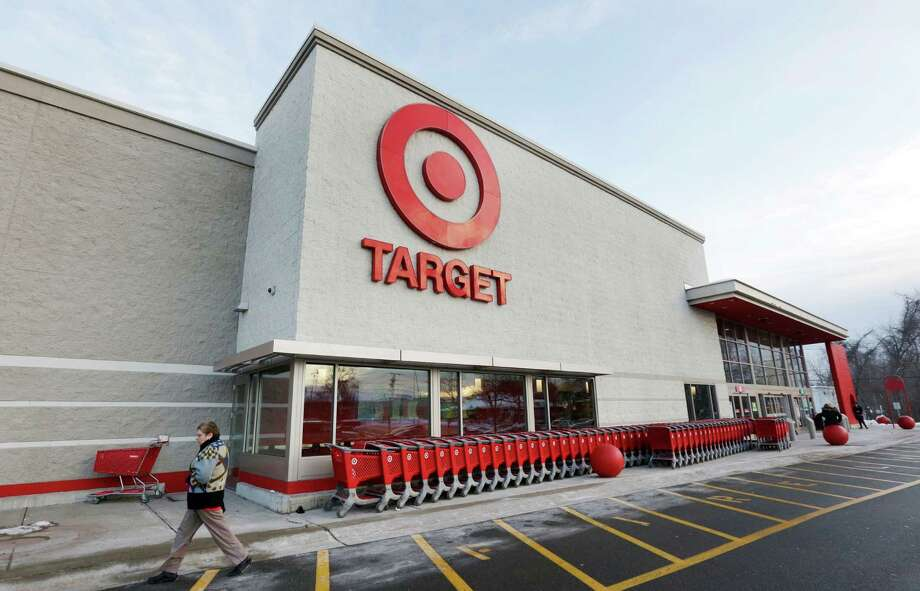 FILE - In this Dec. 19, 2013, file photo, a passer-by walks near an entrance to a Target retail store in Watertown, Mass. Target says that personal information — including phone numbers and email and mailing addresses — was stolen from as many as 70 million customers in its pre-Christmas data breach. That was substantially more customers than Target had previously said were affected. (AP Photo/Steven Senne, File) ORG XMIT: NY118 Photo: Steven Senne / AP