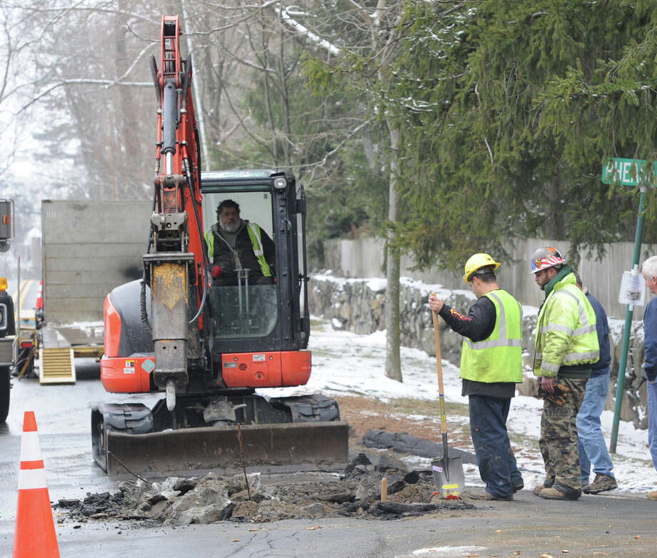 The scene of a water main break on North Malpe Avenue at the intersection with Pheasant Lane in Greenwich, Conn., Friday afternoon, Jan. 10, 2014. Photo: Bob Luckey / Greenwich Time