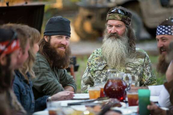 "Phil Robertson, flanked by his sons Jase Robertson, left, and Willie Robertson, stars in the popular A&E series ""Duck Dynasty."""