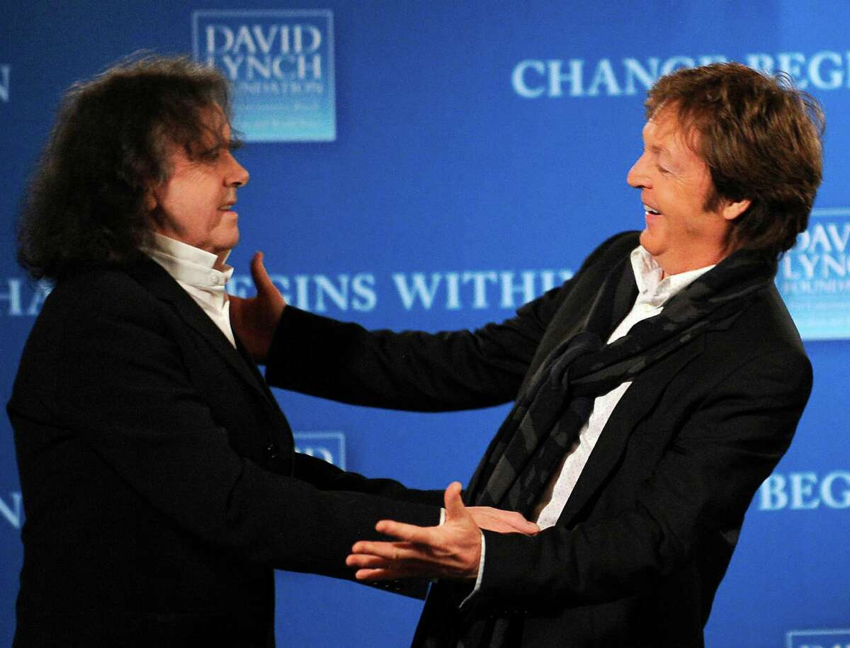 "Paul McCartney, right, greets Donovan, who helped write ""Yellow Submarine."""