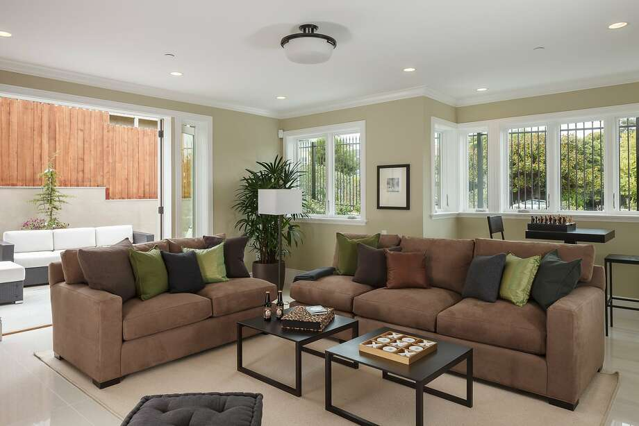 A family room sits off the entry and provides access to the backyard. Photo: Jacob Elliott Photography