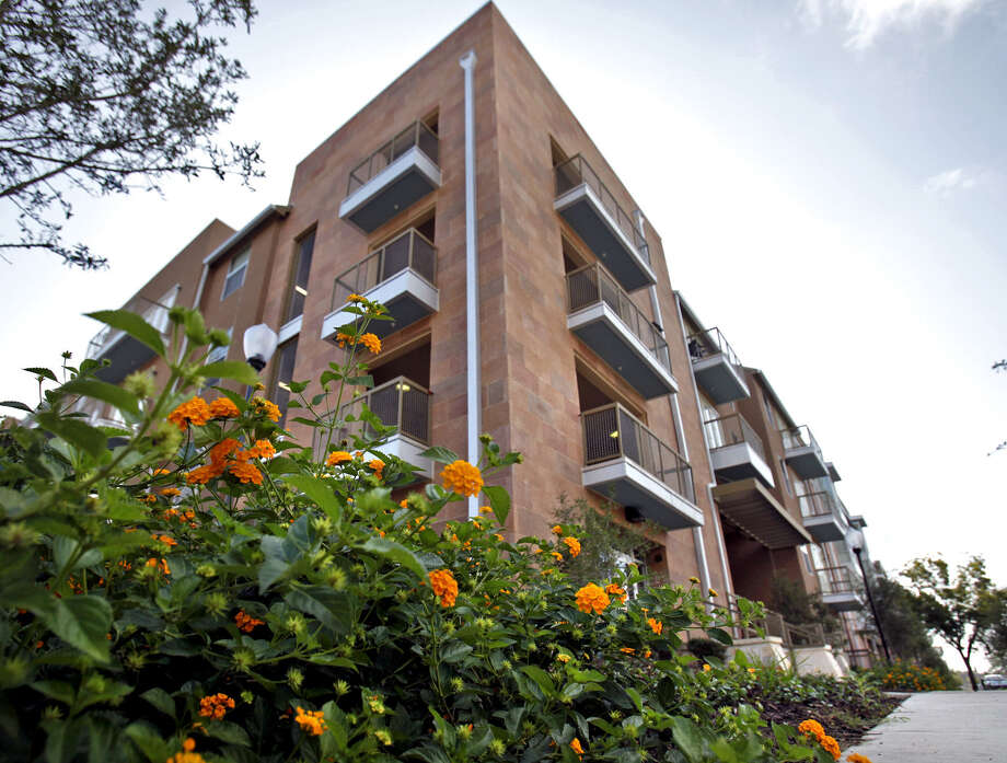 The San Antonio Housing Authority's funding was cut severely by sequestration. SAHA's HemisView Village near HemisFair Park is shown at left. Photo: Express-News File Photo / SAN ANTONIO EXPRESS-NEWS