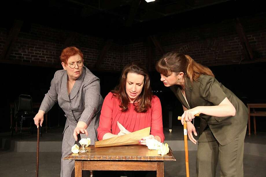 "Thomas Jefferson (Breigh Finnerty, center) works on the Declaration of Independence, goaded by Benjamin Franklin (Ruth E. Stein, left) and John Adams (Mary Melnick) in Tabard Theatre's all-female ""1776."" Photo: Tabard Theatre Company"