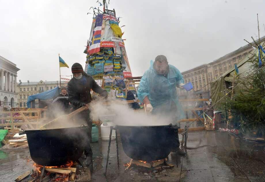 Ukraine: Protesters cook the celebratory dinner in the Ukrainian opposition tent camp on Independence Square in Kiev. Photo: Sergei Supinsky, AFP/Getty Images