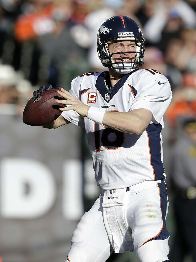 Denver Broncos quarterback Peyton Manning (18) against the Oakland Raiders during an NFL football game in Oakland, Calif., Sunday, Dec. 29, 2013. (AP Photo/Tony Avelar) Photo: Tony Avelar, Associated Press