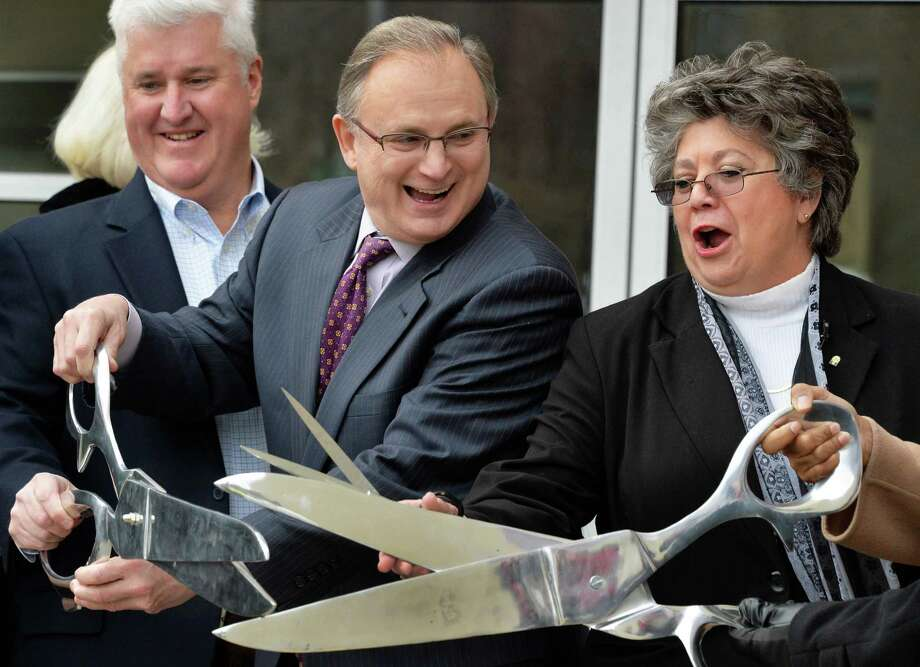Kevin Bette, left, of First Columbia, HVCC president Drew Matonak and EOC director Lucille Marion, at right, during ribbon cutting ceremonies for the Capital District Educational Opportunity Center's new facility at 431 River Street Friday Jan. 10, 2014, in Troy, NY.  (John Carl D'Annibale / Times Union) Photo: John Carl D'Annibale / 00025271A