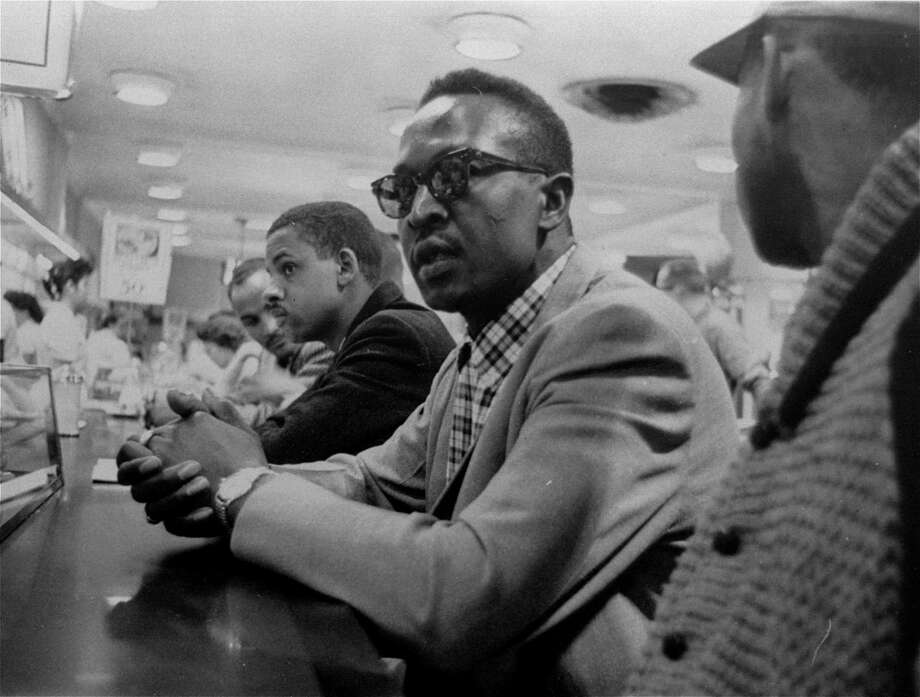 Franklin McCain, in glasses, waits in vain for service at a lunch counter in Greensboro, N.C., in this photo taken in 1960. McCain, who staged the first sit-in with three fellow college students, died Thursday at age 71. Photo: Anonymous, MBR / GREENSBORO NEWS & RECORD
