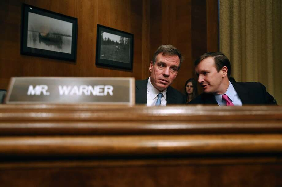 2. Sen. Mark Warner, D-VA, (L) has a net worth that's between $96,221,316 and $418,742,000. The average puts him at  $257,481,658. Photo: Chip Somodevilla, Getty Images