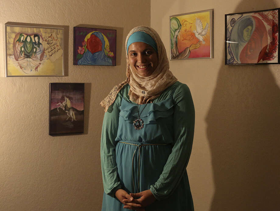Amira Alsareinye, a college student, shows five of her paintings. She said Islamic images and stories inspired her works, but they're offered in this environment to foster understanding. Photo: Lisa Krantz / San Antonio Express-News / San Antonio Express-News