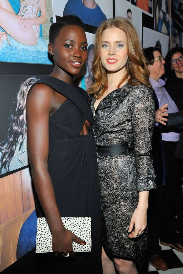 "Actress Lupita Nyong'o (L) and actress Amy Adams attend the W Magazine celebration of The ""Best Performances"" Portfolio and The Golden Globes with Cadillac and Dom Perignon at Chateau Marmont on January 9, 2014 in Los Angeles, California. Photo: Donato Sardella, Getty Images For W Magazine"