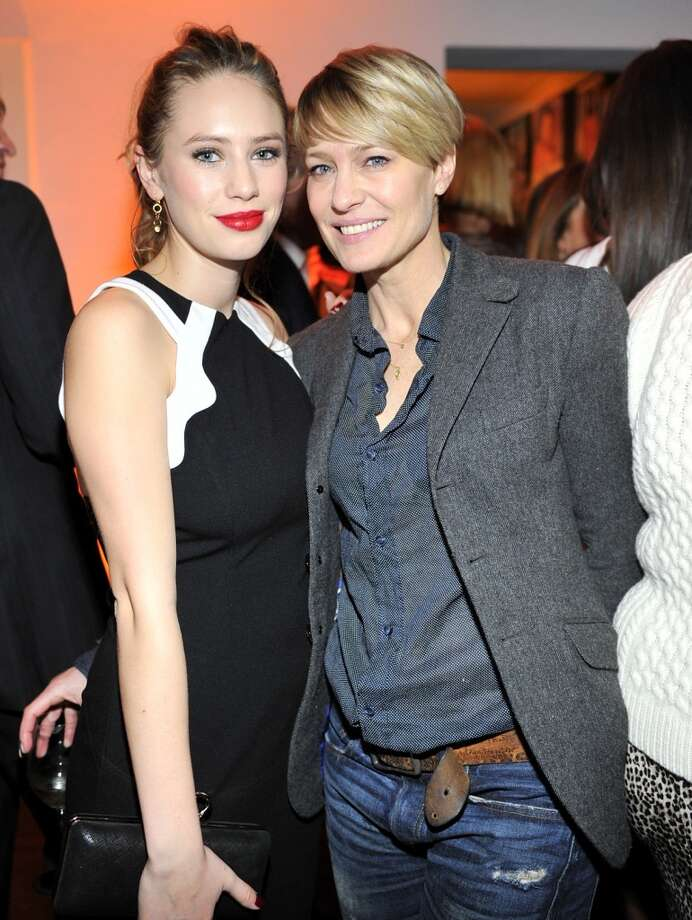 "Actress Dylan Penn (L) and actress Robin Wright attend the W Magazine celebration of The ""Best Performances"" Portfolio and The Golden Globes with Cadillac and Dom Perignon at Chateau Marmont on January 9, 2014 in Los Angeles, California. Photo: Donato Sardella, Getty Images For W Magazine"