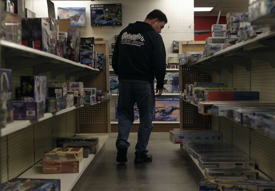 Dan Gomez browses through the dwindling selection of plastic model kits at Franciscan Hobbies in S.F. Photo: Paul Chinn, The Chronicle