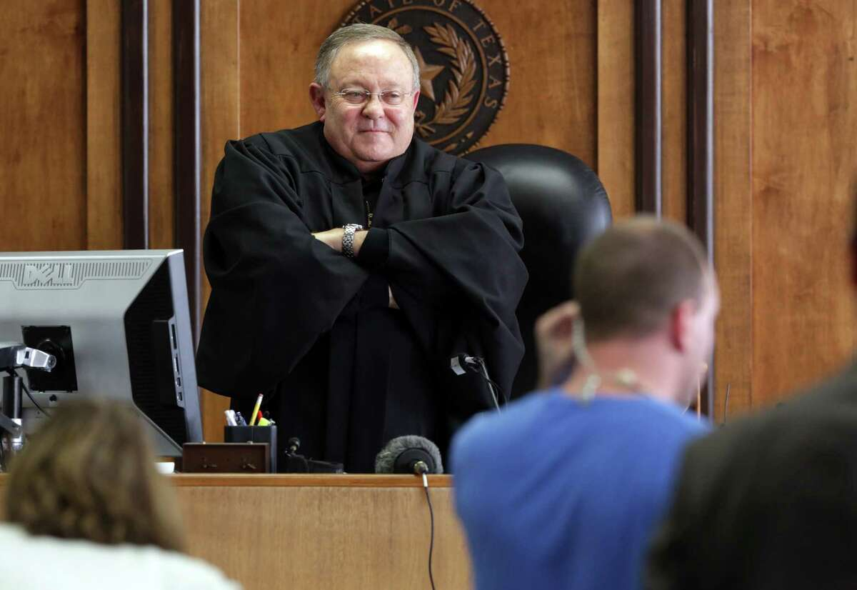 Judge John K. Dietz looks over the 250th Judicial District Court in Travis County Courthouse in Austin, TX, after he ruled that the way the state funds schools violates the Texas Constitution, Monday, Feb. 4, 2013
