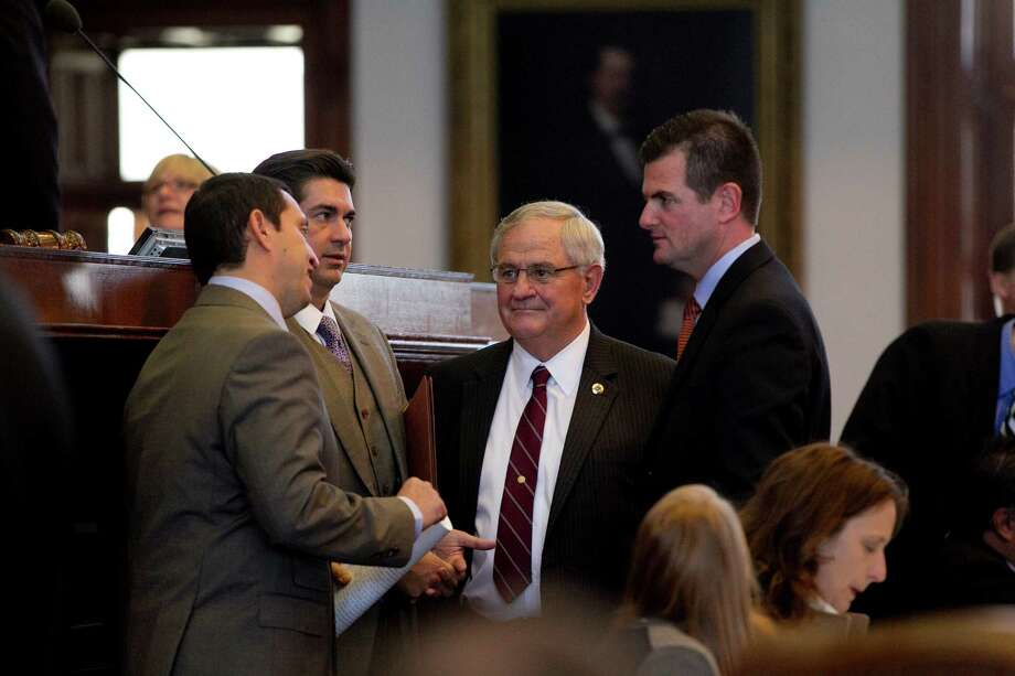 From left, Rep. Trey Martinez Fischer, Rep. Eddie Rodriquez, Rep. Jimmie Don Aycock and Rep. Brandon Creighton speak near the dais on the House floor at the Capitol during debate on House Bill 5 in Austin, Texas, on Tuesday, March 26, 2013. (AP Photo/Austin American-Statesman, Deborah Cannon) Photo: Deborah Cannon, MBO / Austin American-Statesman