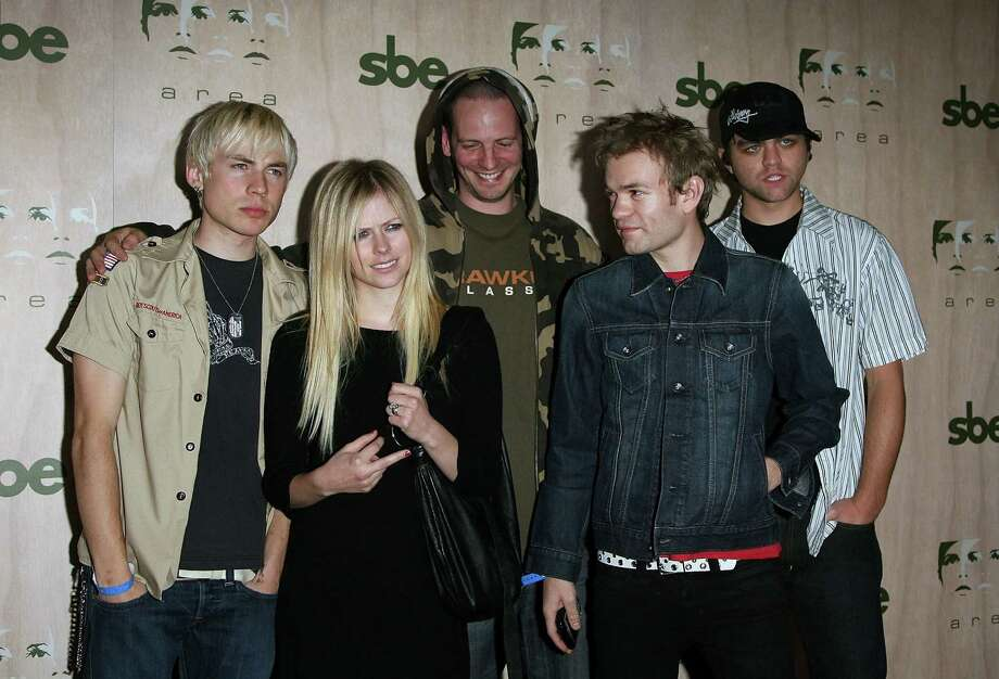 Singer Avril Lavigne wed Deryck Whibley (front right) at age 21. They divorced in 2010. Photo: Michael Buckner, Getty Images / 2006 Getty Images