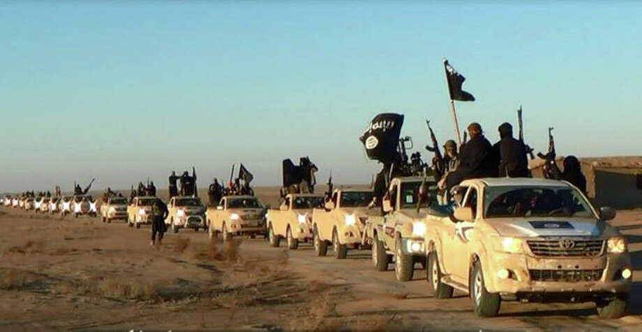 This image posted on a militant website on Tuesday, Jan. 7, 2014, which is consistent with AP reporting, shows a convoy of vehicles and fighters from the al-Qaida linked Islamic State of Iraq and the Levant  (ISIL) fighters in Iraq's Anbar Province. With al-Qaida linked fighters and allied tribal gunmen camped on the outskirts, a tentative calm takes hold over Fallujah and residents start to return to the besieged city west of Baghdad. Government forces are stationed nearby as sporadic street fighting breaks out in other cities. The picture painted by residents, officials and international groups suggests that both the militants and government forces are preparing for a long standoff with civilians caught in the middle.(AP Photo via militant website) Photo: Uncredited, HOPD / militant website