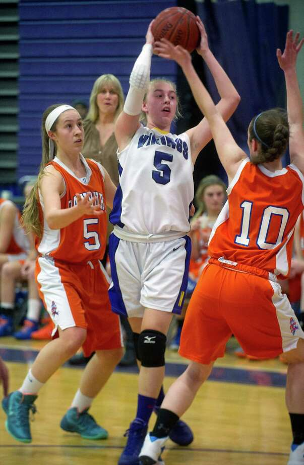 Westhill's Steph Roones is guarded by Danbury's Rachel Gartner, left, and Shannon Geary, right, during Friday's girls basketball game at Westhill High School in Stamford, Conn., on January 10, 2014. Photo: Lindsay Perry / Stamford Advocate