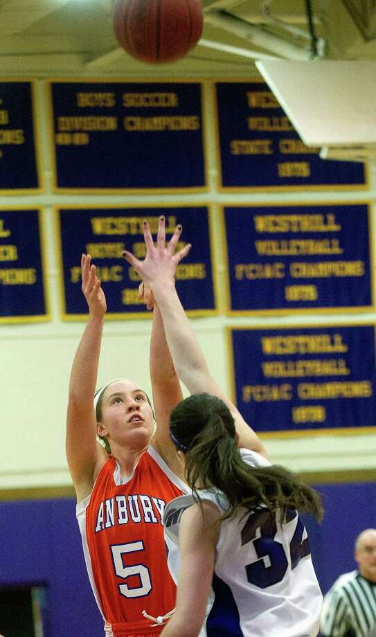 Danbury's Rachel Gartner takes a shot during Friday's girls basketball game at Westhill High School in Stamford, Conn., on January 10, 2014. Photo: Lindsay Perry / Stamford Advocate