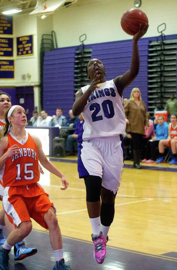 Westhill's Tyler Evans takes a shot during Friday's girls basketball game at Westhill High School in Stamford, Conn., on January 10, 2014. Photo: Lindsay Perry / Stamford Advocate