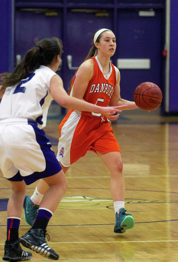 Danbury's Rachel Gartner controls the ball during Friday's girls basketball game at Westhill High School in Stamford, Conn., on January 10, 2014. Photo: Lindsay Perry / Stamford Advocate