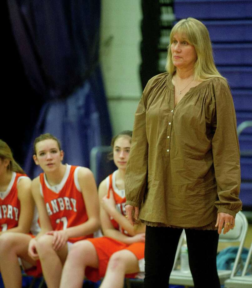Danbury coach Jackie DiNardo watches Friday's girls basketball game at Westhill High School in Stamford, Conn., on January 10, 2014. Photo: Lindsay Perry / Stamford Advocate