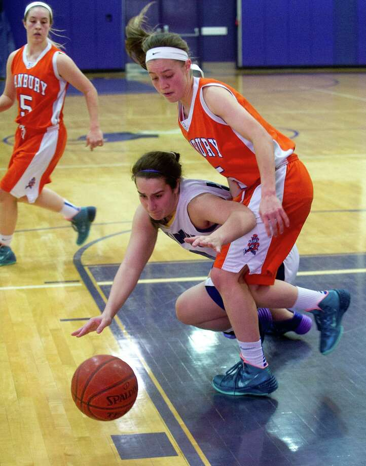 Westhill's Elizabeth Grasso, center, and Danbury's Rebecca Gartner, right, reach for the ball during Friday's girls basketball game at Westhill High School in Stamford, Conn., on January 10, 2014. Photo: Lindsay Perry / Stamford Advocate