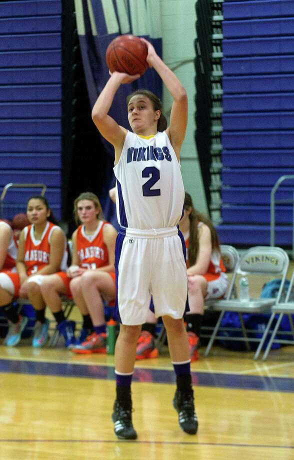 Westhill's Edona Thaqi takes a shot during Friday's girls basketball game against Danbury at Westhill High School in Stamford, Conn., on January 10, 2014. Photo: Lindsay Perry / Stamford Advocate
