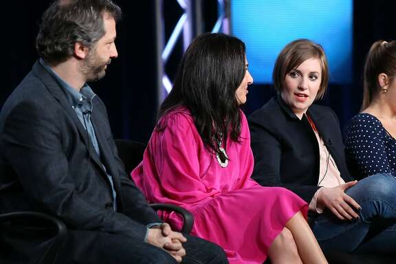 PASADENA, CA - JANUARY 09:  (L-R) Executive Producer Judd Apatow, Executive Producer Jenni Konner and Creator/Executive Producer/Actress Lena Dunham speak onstage during the 'Girls' panel discussion at the HBO portion of the 2014  Winter Television Critics Association tour at the Langham Hotel on January 9, 2014 in Pasadena, California.  (Photo by Frederick M. Brown/Getty Images)