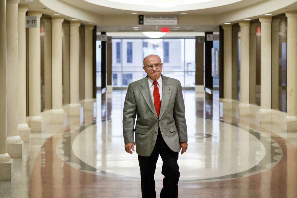 Dave Wilson walks through the Harris County Civil Courthouse on his way to the 151st state District Court for Friday's hearing.
