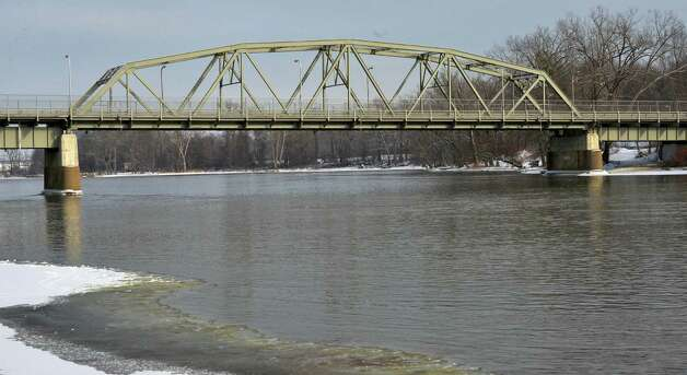 The Hudson River flows ice free under the Mechanicville Bridge (also known as the Hemstreet Park Bridge) carrying NYS Route 67 connecting Mechanicville, left, with Hemstreet Park in the Town of Schaghticoke Friday Jan. 10, 2014, in Mechanicville, NY.  (John Carl D'Annibale / Times Union) Photo: John Carl D'Annibale / 00025315A